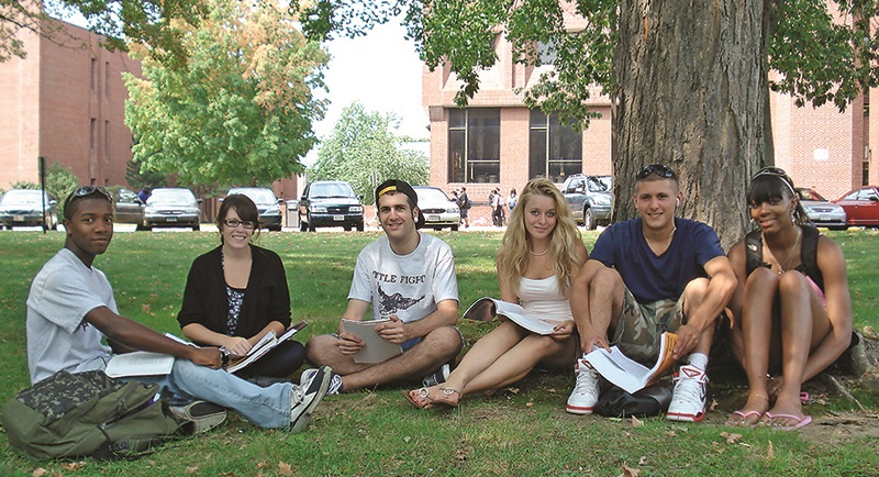 Image of students sitting on STCC campus green