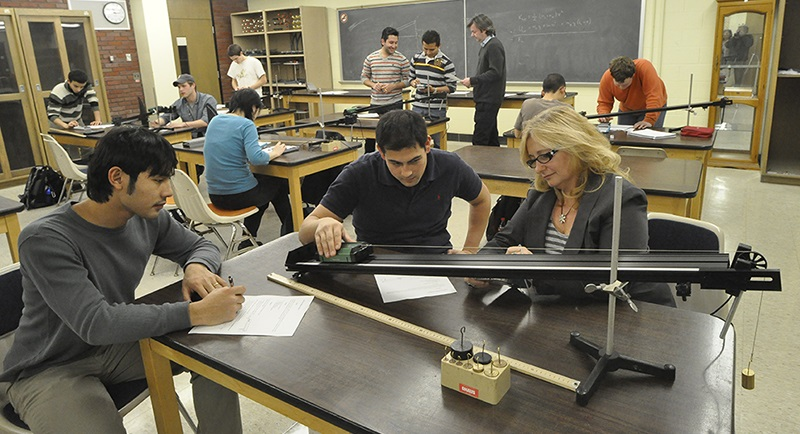 Image of students and faculty at work in a physics lab